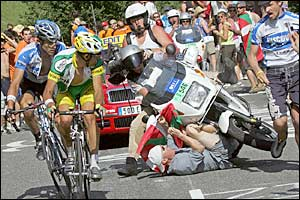 Among those recuperating today will be George Hincapie (far left), Oscar Pereiro (near left), and some dimwit who ran onto the course and got hit by a motorbike (bottom center).